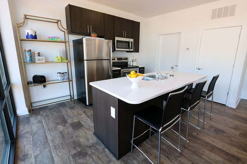 109-Park-Raleigh-NC-Kitchen-With-Breakfast-Bar-Unilodgers