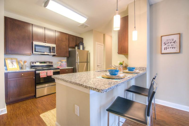 Station-At-Five-Points-Columbia-SC-Kitchen-With-Breakfast-Bar-Unilodgers
