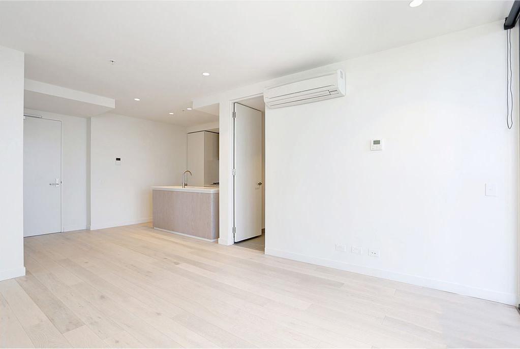4306-135-A'Beckett-Street-Living-Room-Unilodgers