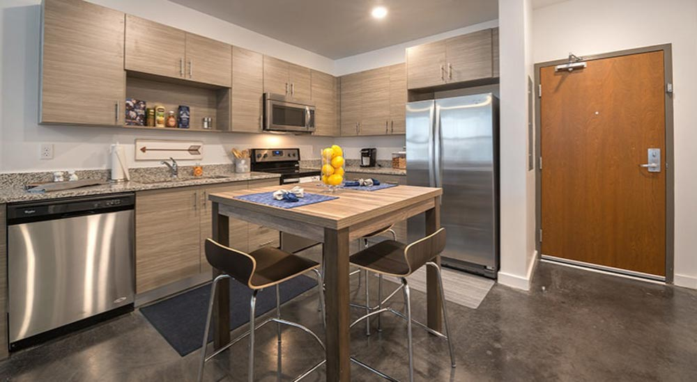 College-Town-Student-Apartments-Tallahassee-FL-Kitchen-With-Dining-Table-Unilodgers