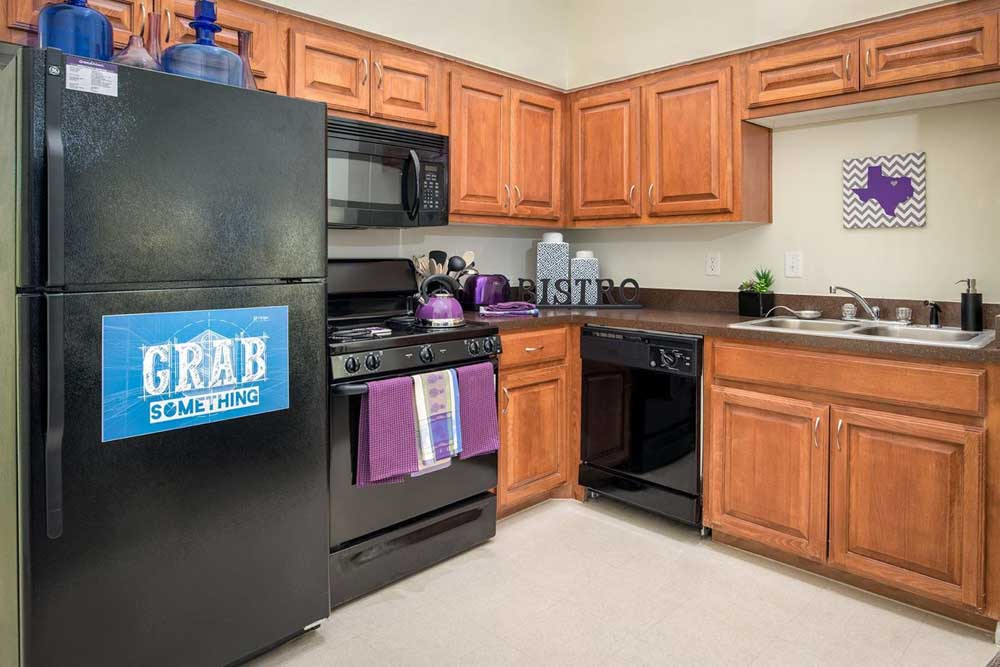 Grandmarc-At-Westberry-Place-Fort-Worth-TX-Kitchen-With-Fridge-Unilodgers