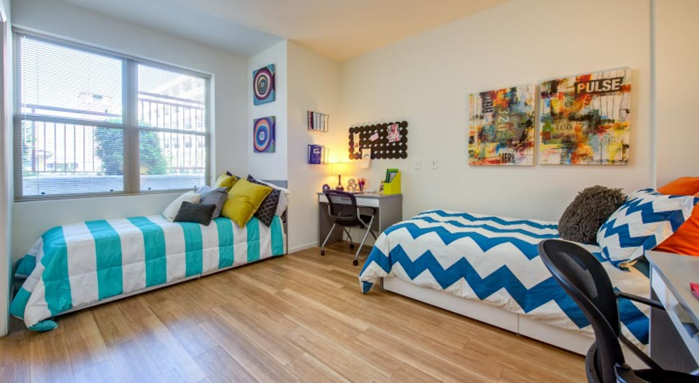 Icon-Plaza-Apartments-Los-Angeles-CA-Bedroom-With-Study-Desk-And-Chair-Unilodgers