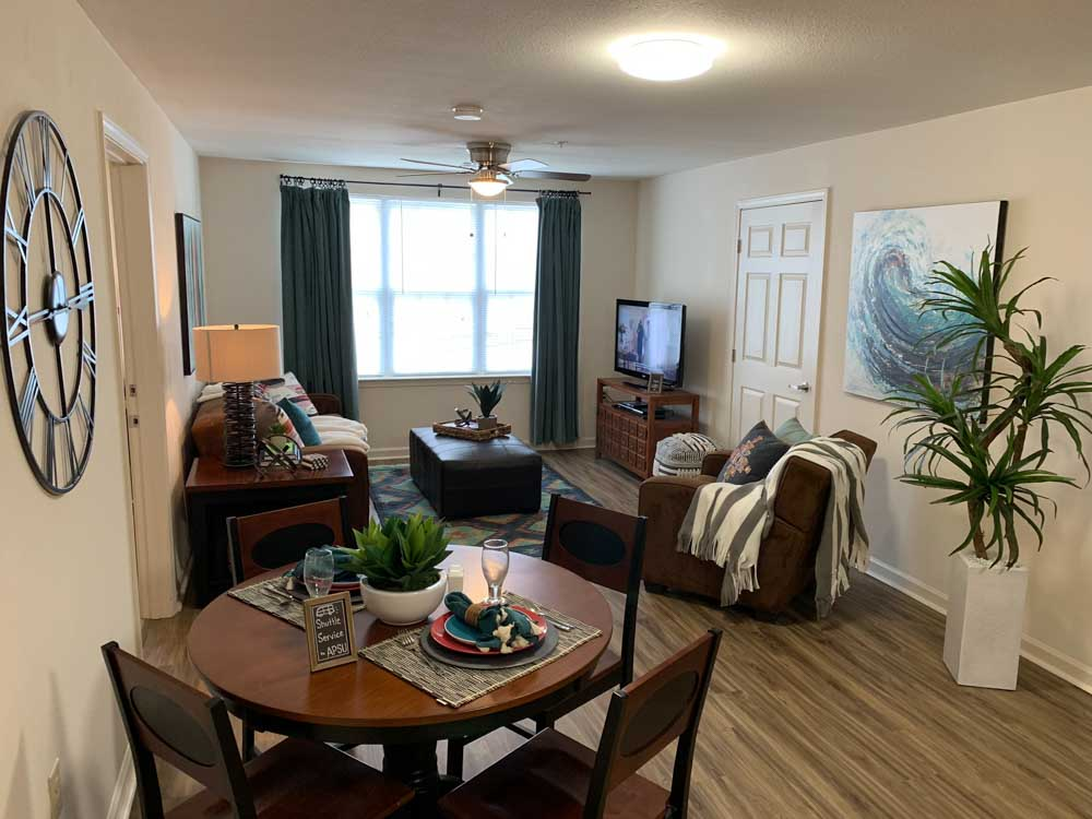 Lakeview-At-Market-District-Statesboro-GA-Living-Room-With-Dining-Area-Unilodgers