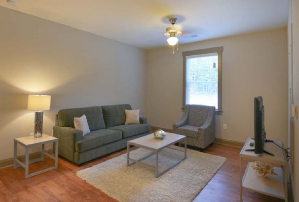 Plato's-Lofts-At-Randall-Wilmington-NC-Living-Area-With-TV-Unilodgers
