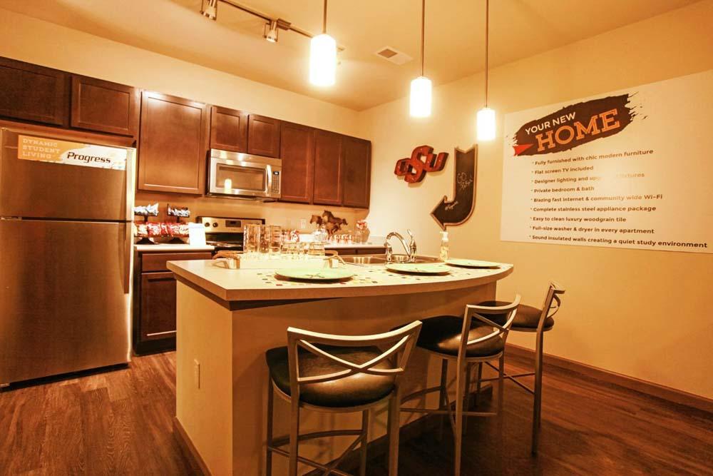 Progress-405-Stillwater-OK-Kitchen-With-Fridge-And-Breakfast-Bar-Unilodgers
