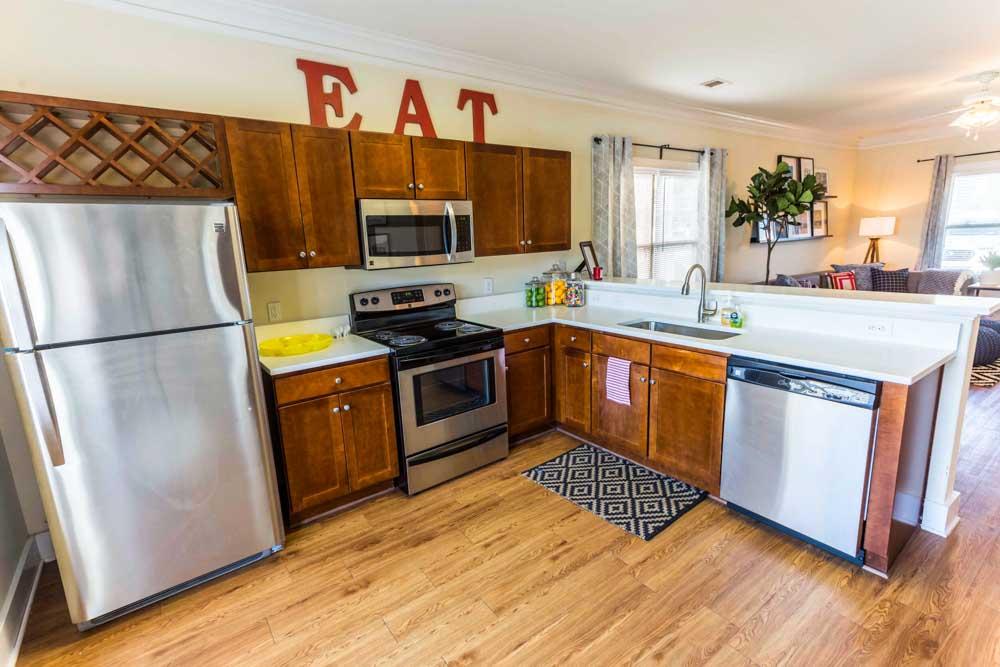 The-Cottages-At-Lake-Tamaha-Tuscaloosa-AL-Kitchen-With-Fridge-Unilodgers