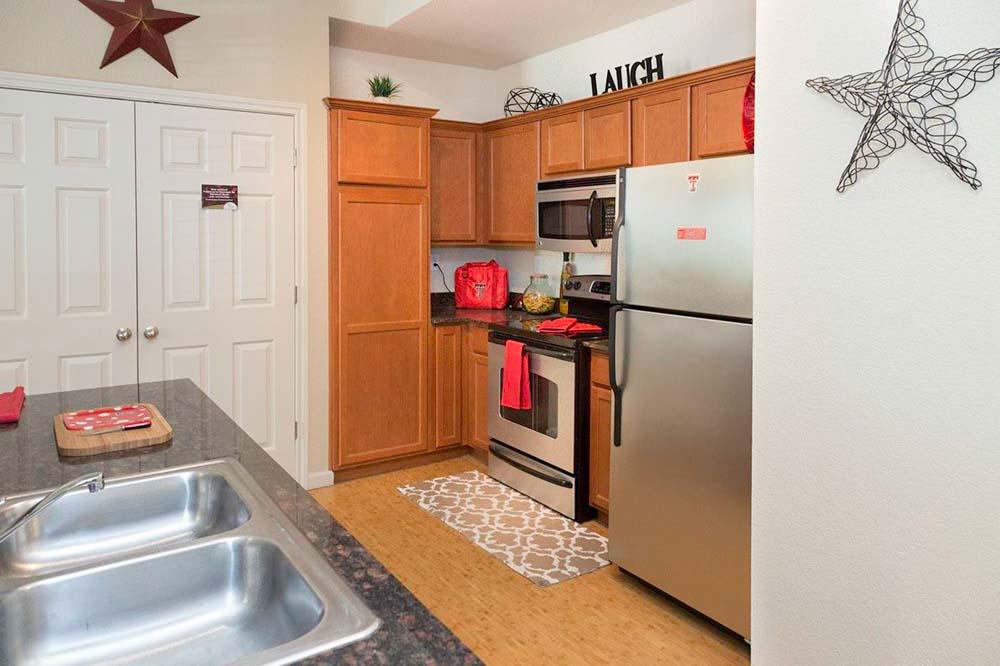 The-Suites-At-Overton-Park-Lubbock-TX-Kitchen-With-Fridge-Unilodgers