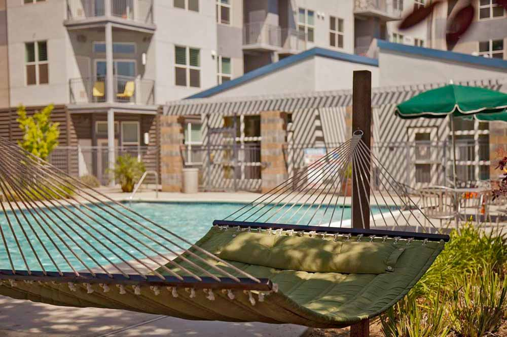 Upper-Eastside-Lofts-Sacramento-CA-Swimming-Pool-With-Hammock-Garden-Unilodgers